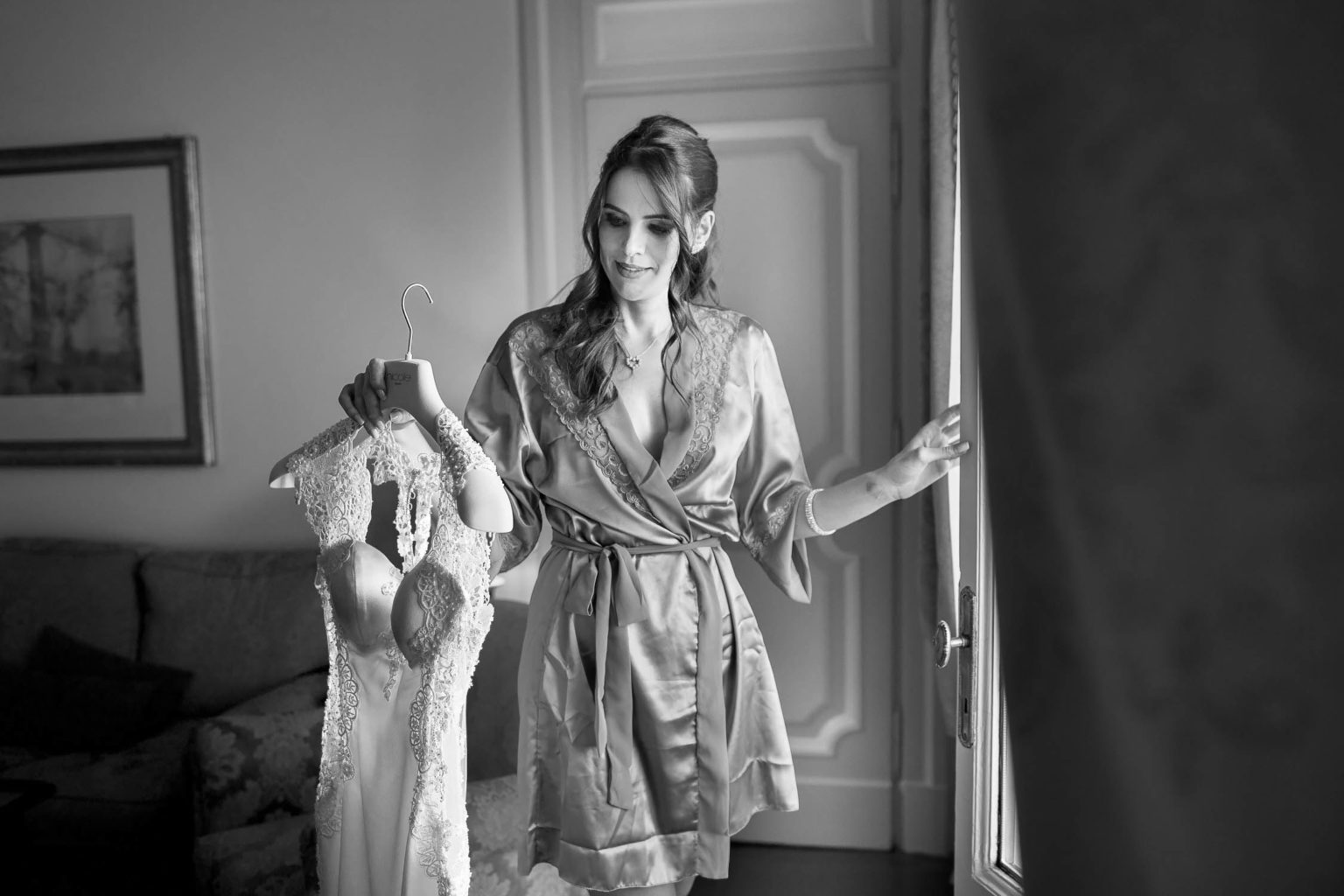 Sposa admires her dress at the San Domenico Palace for a wedding in Taormina, a wedding photo by Nino Lombardo