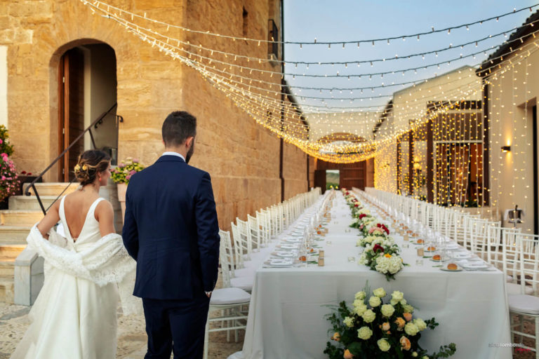 Wedding Photographer Trapani immortalized The bride and groom admire their imperial table
